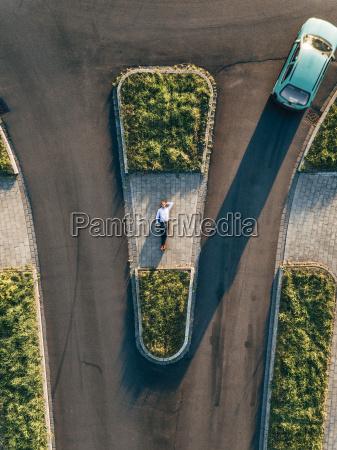 businessman lying on traffic island