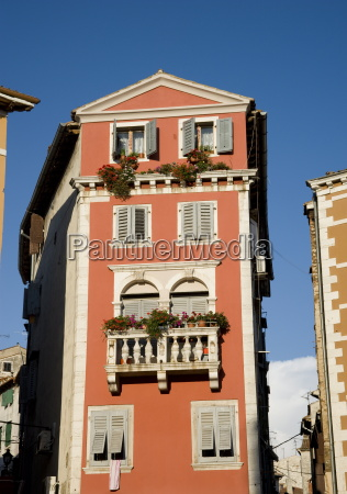 a brightly colored building in rovinj