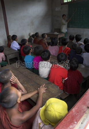 school children in classroom listening to