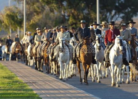 spanish horsemen in feria procession tarifa