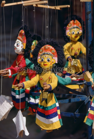 brightly colored wooden carved puppets on
