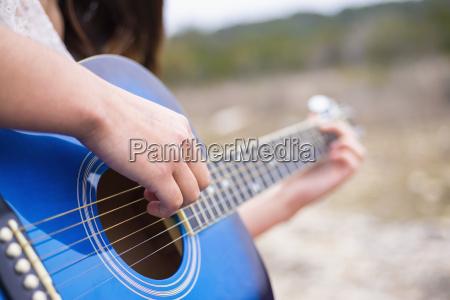 usa texas teenage girl playing guitar