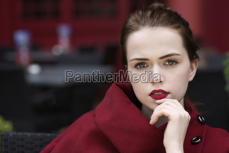 portrait of young woman with red