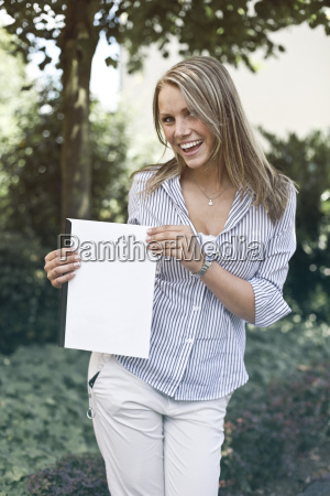 germany duesseldorf young woman holding folder