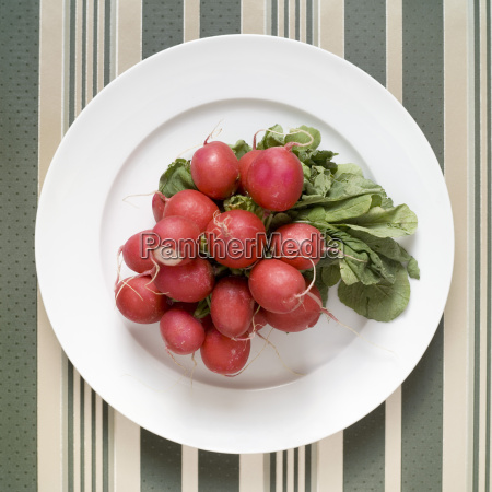 bunch of radishes on plate elevated