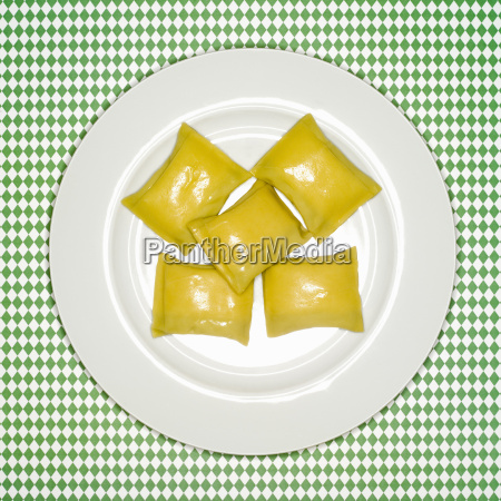 uncooked swabian pockets on plate elevated