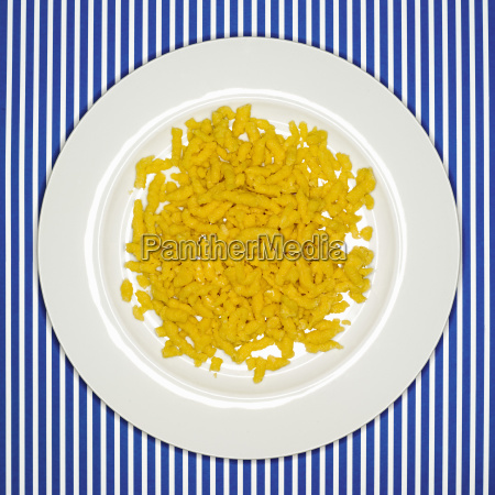 uncooked spaetzle on plate elevated view