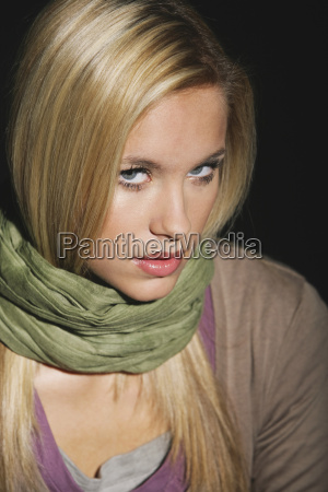 young woman wearing scarf portrait close