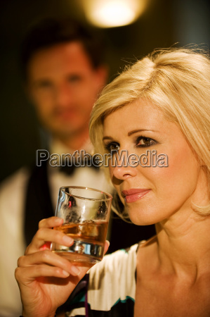 young woman in bar holding glass
