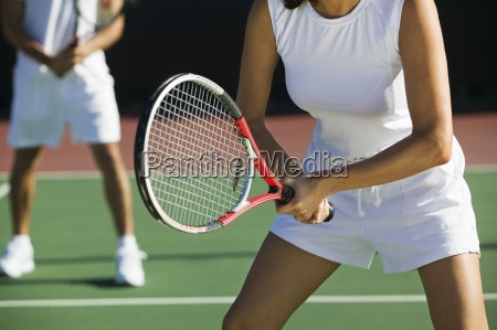 midsection af mixed double tennis spillere
