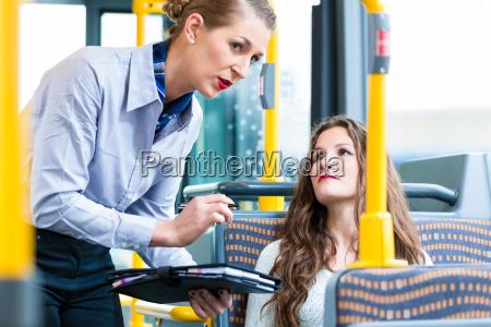woman in bus having no valid