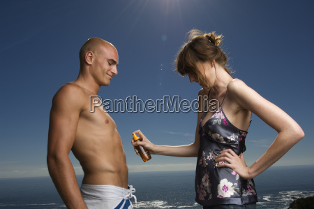 shirtless man and woman standing in