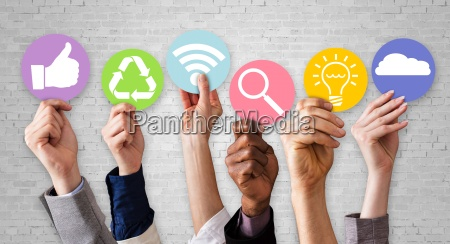 people hands holding various business symbols