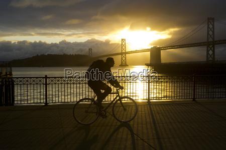 man riding along golden gate at