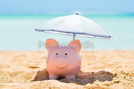 piggy bank under parasol pa strand