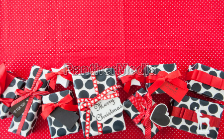 little presents with red ribbons