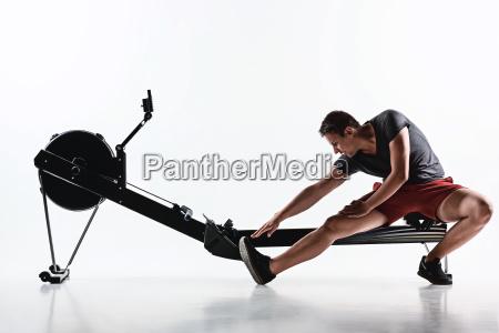 man using a press machine in