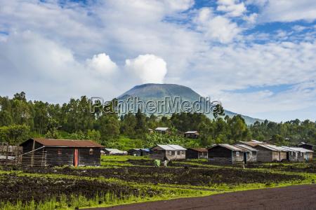 mount nyiragongo looming behind the town