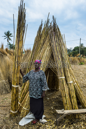 friendly woman sells reeds on the