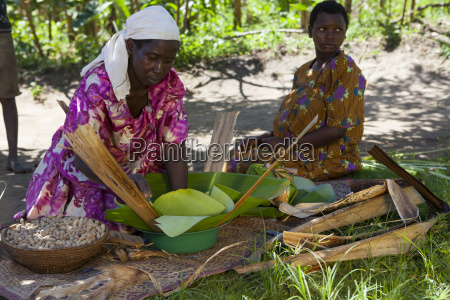 a woman wraps some groundnuts in