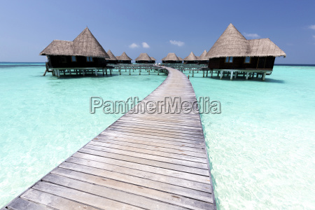 over water villas crystal clear sea