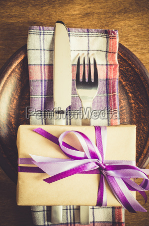 festive table setting with present