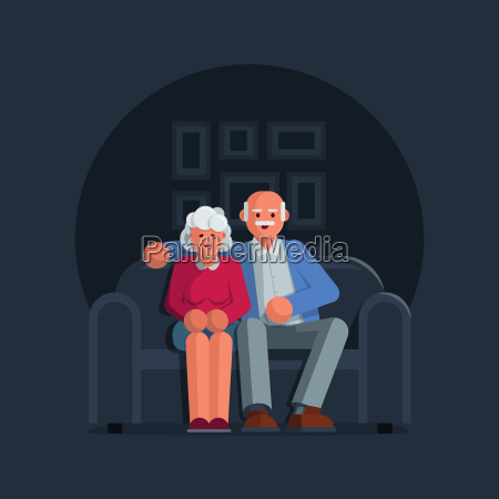 happy elderly couple sitting on a