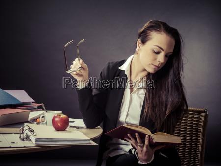 teacher sitting at her messy desk