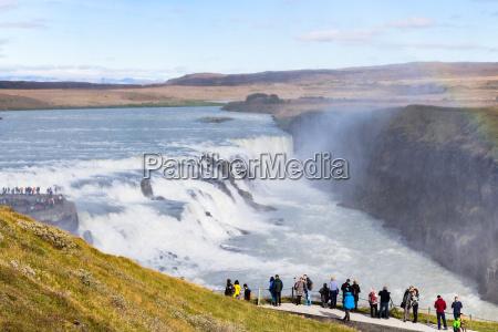 visitors at viewpoint near gullfoss waterfall