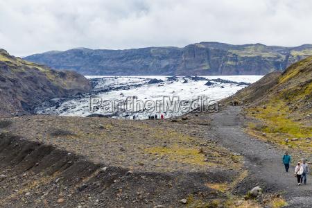 tourists on path to solheimajokull glacier