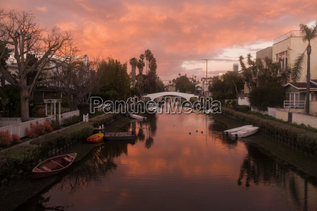 sunset above canal in venice california