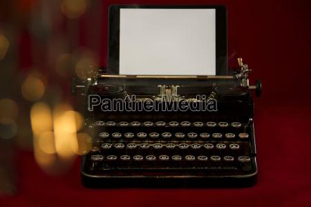 anciently nostalgic typewriter backdrop background red