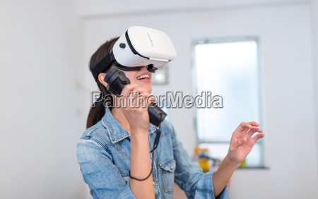 woman play game with virtual reality