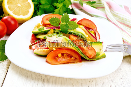 salad with zucchini and tomato on