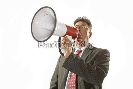 forretningsmand raber i megafon