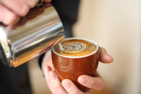 pouring milk into cup san francisco