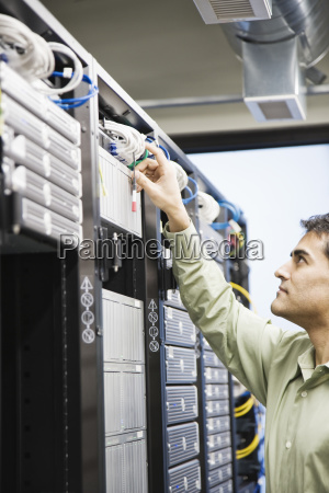 male computer technician working on servers