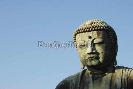 close up of giant buddha statue