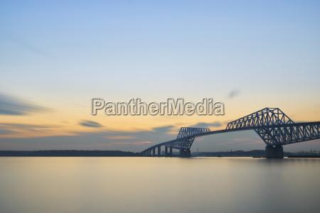 tokyo gate bridge over bay against