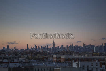 cityscape against sky during sunset
