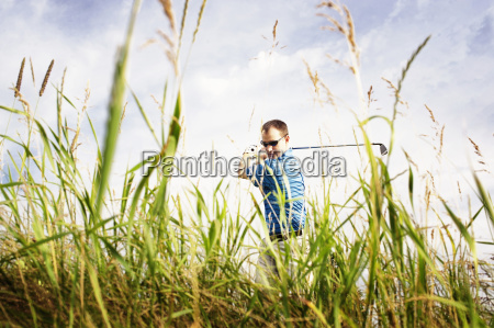 confident man playing golf on field