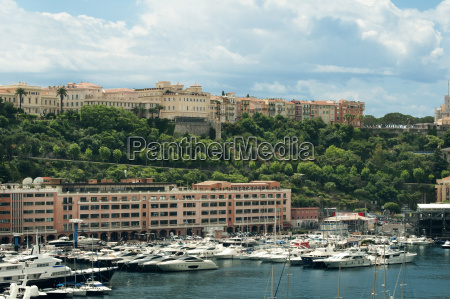 yachts moored on sea by buildings