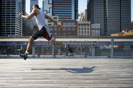 side view of man jumping on