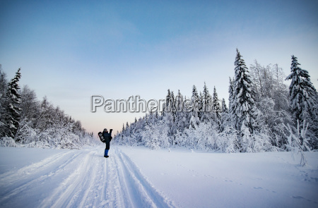 hiker standing on snow covered field