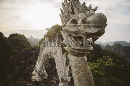 dragon sculpture on mountain against sky