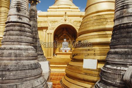 buddha statue with stupas at shwe