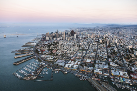 aerial view of cityscape by sea