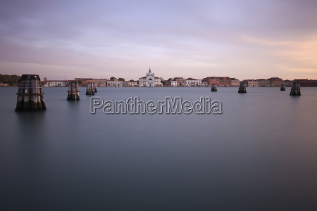grand canal by buildings against cloudy