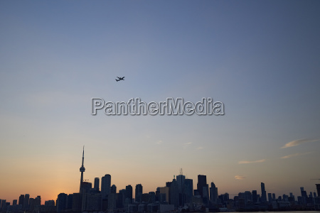 low angle view of silhouette cityscape