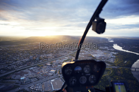 cityscape seen through helicopter during sunset